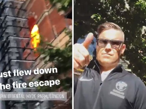 Robbie Williams gives thumbs up as he evacuates Mandarin Oriental blaze