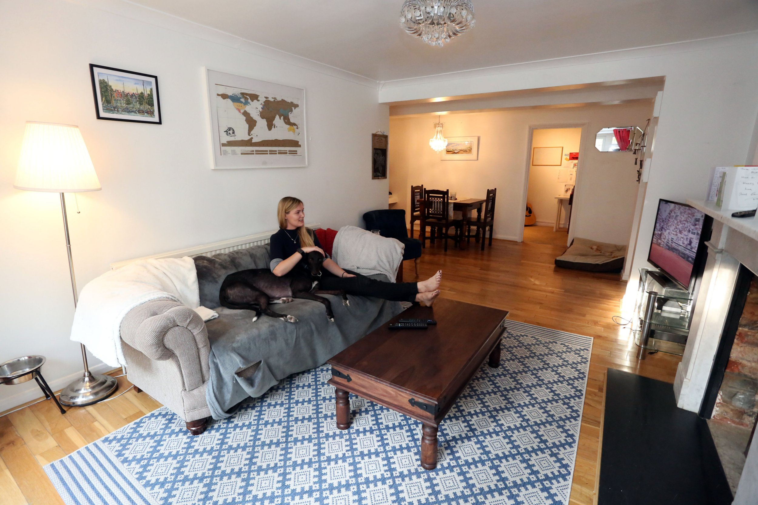 LONDON, UNITED KINGDOM, JUNE 6TH 2018. WHAT I RENT CASE STUDY: Tenant Samantha 'Sammy' Hull is pictured with her Greyhound Koda in the living room of her two bedroom flat which she shares with her boyfriend Matt Preece in Gispy Hill, London, United Kingdom, June 6th 2018. Samantha and Matt pay ?1625 a month excluding bills and council tax. Photo credit: Susannah Ireland