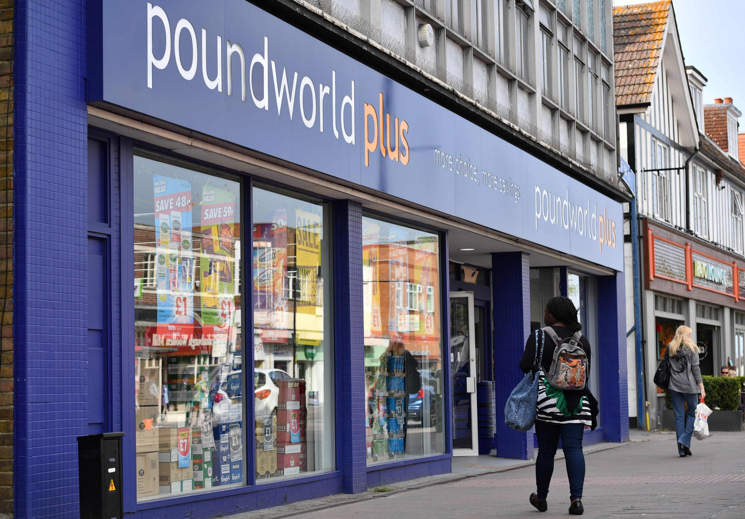 Pedestrians walk past the entrance to a Poundworld Plus discount store in Orpington, south-east London, on June 7, 2018. Budget chain Poundworld is seeking a rescue plan to safeguard more than 5,000 jobs, according to a source. / AFP PHOTO / Ben STANSALLBEN STANSALL/AFP/Getty Images