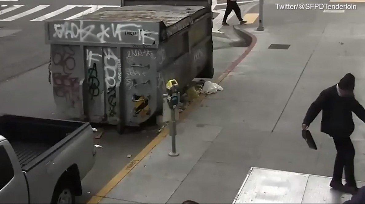 Smartly dressed man kicks homeless man METRO GRAB taken from: http://video.metro.co.uk/video/met/2018/06/08/1919667197261623608/1024x576_MP4_1919667197261623608.mp4 Credit: SFPDTenderloin/Twitter