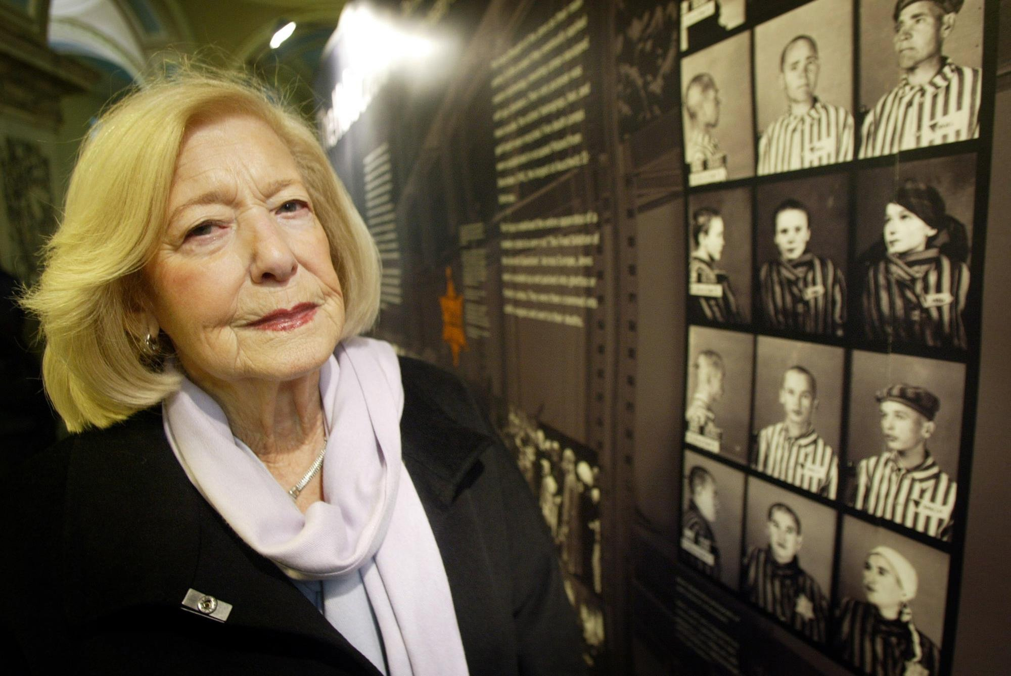 Holocaust Survivor Gena turgel, examines a Holocaust Memorial board at Belfast City Hall ahead of speaking at the UK's main commemoration for National Holocaust Memorial Day.