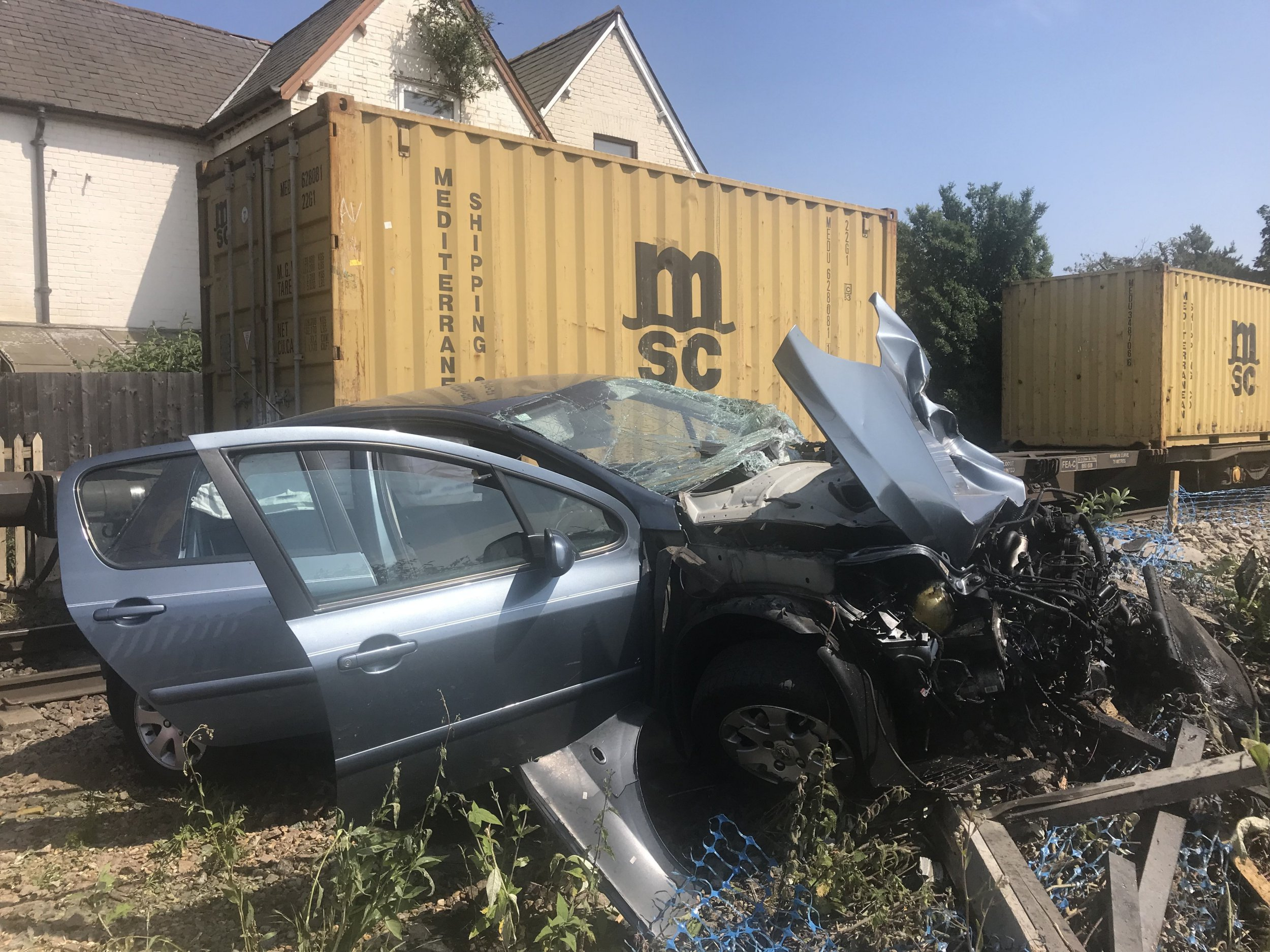 Driver arrested after freight train smashes car with a baby still inside