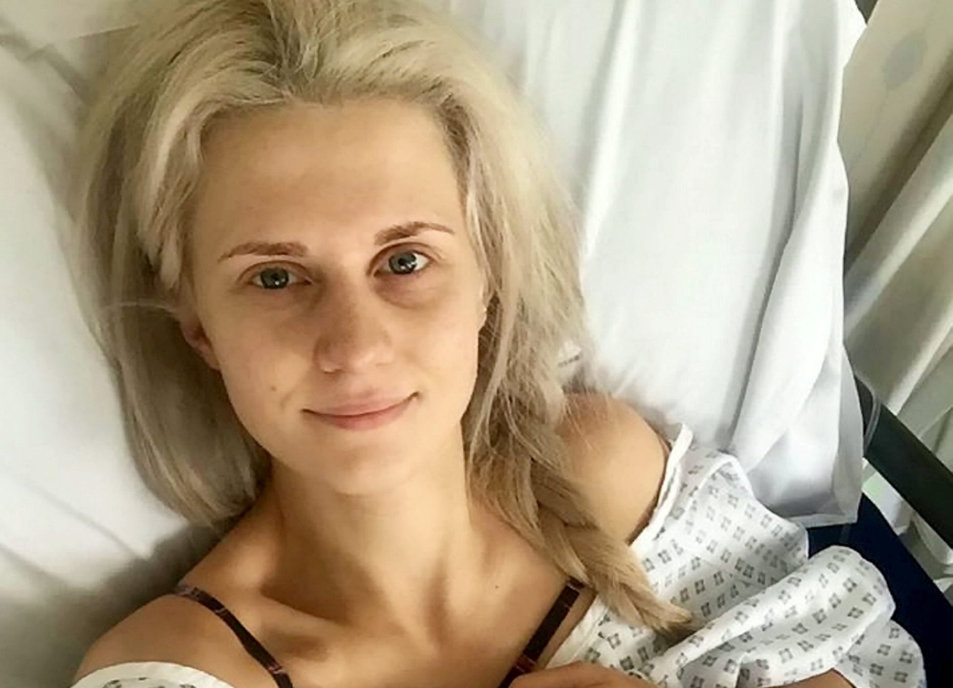 """Esther Taylor in hospital. A woman has become one of the youngest in the UK to have a double mastectomy at the age of 24 -- to beat her family?s cancer curse. See ROSS PARRY story RPYCANCER. Esther Taylor has a gene mutation meaning she is at """"high risk"""" after nine of her relatives contracted the disease. She underwent the gruelling nine-hour procedure on March 2 this year in a preventative operation to beat the scourge of cancer which has haunted her family. The paediatric nurse, now 25, from Preston, Lancs., has been offered support from Liberty X pop star Michelle Heaton, who also underwent the procedure. Now, Esther believes she can look with optimism to a healthy future despite many thinking she was ?too young? to make such a major decision. Blood tests revealed that she had a rogue unidentified gene, putting her at high risk for breast and ovarian cancer. It follows several members of her family being diagnosed with cancer including aunties, uncles and her mum Patsy, who was struck down in her 40s."""