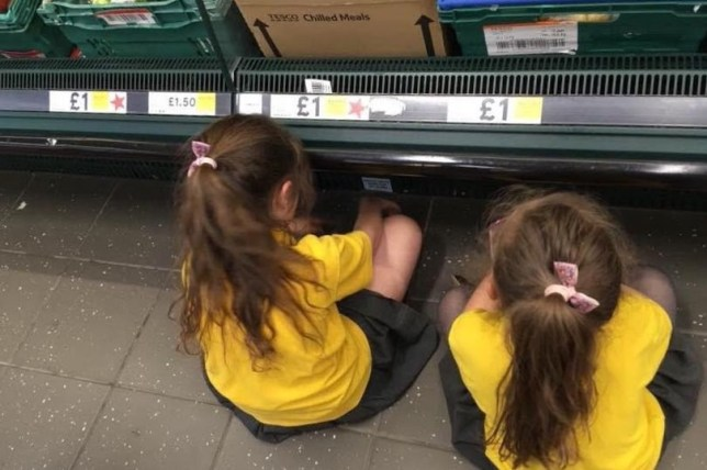 Louise Palai's daughters Ebony and Alissia of Ilkeston, being publicly punished because they had been running around the Tesco store and making too much noise. June 11 2018. See NTI story NTIMUM. A mum who punished her misbehaving daughters by making them sit on the floor in silence in a vegetable aisle in Tesco ? has been praised. Louise Palai, 35, disciplined her daughters Alisa, 6, and Ebony, 7, after they were messing around during a shop on June 5. She said the two were running around the store being a nuisance and one was nearly hit by a trolley. It was at that point the full-time mum-of-three told the youngsters to sit down on the floor of the vegetable aisle in Tesco on Rutland Street, Ilkeston. After a seven minute time out the pair said sorry to their mum and gave her a hug before they all continued their shop. The tough love tactic worked after the two were on their best behaviour when they went back to Tesco yesterday (10/6).