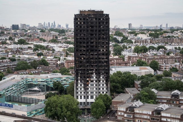 LONDON, ENGLAND - JUNE 26: The remains of Grenfell Tower are seen from a neighbouring tower block on June 26, 2017 in London, England. 79 people have been confirmed dead and dozens still missing after the 24 storey residential Grenfell Tower block was engulfed in flames in the early hours of June 14, 2017. (Photo by Carl Court/Getty Images)
