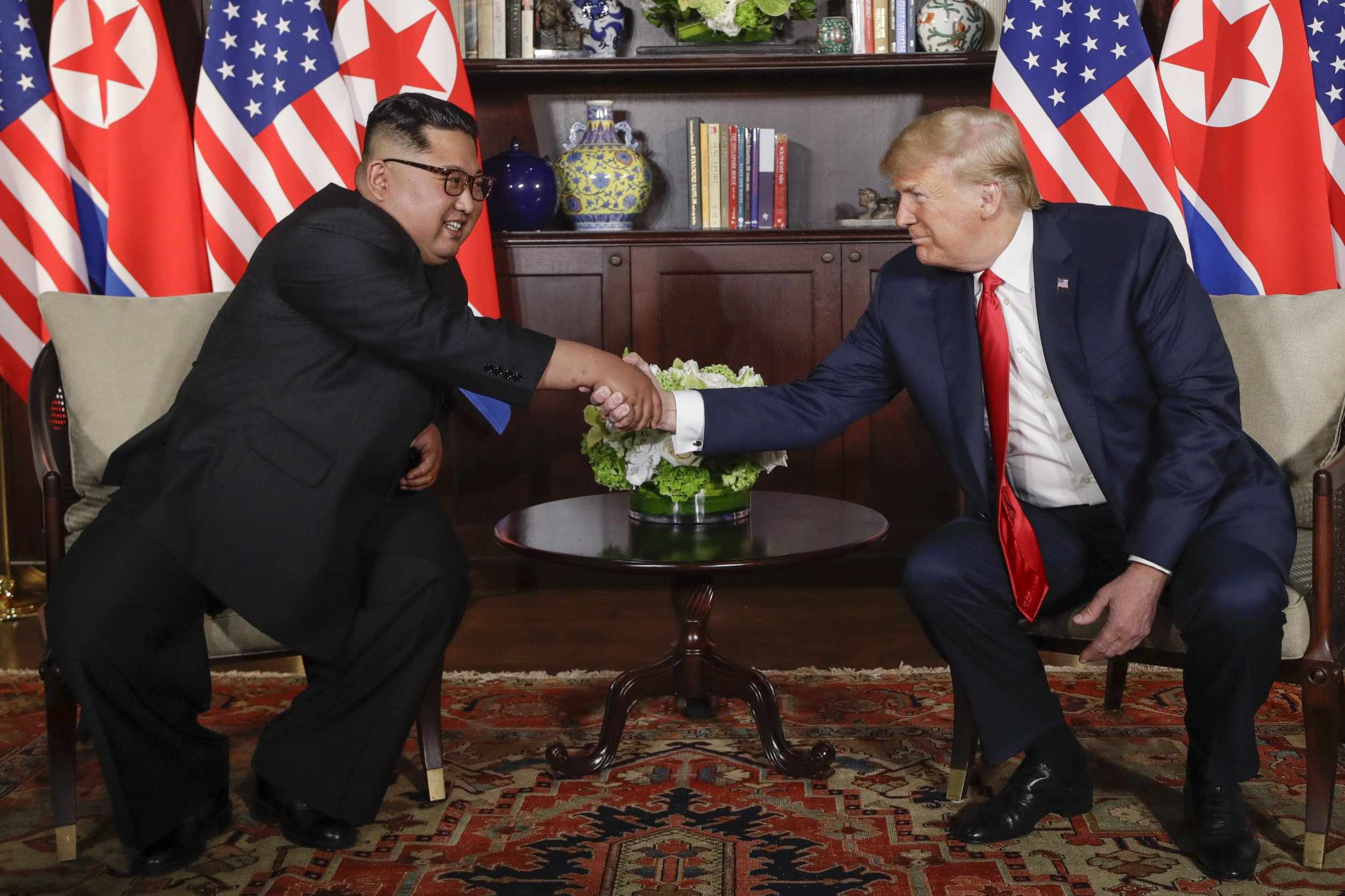 U. S. President Donald Trump shakes hands with North Korea leader Kim Jong Un during their first meetings at the Capella resort on Sentosa Island Tuesday, June 12, 2018 in Singapore. (AP Photo/Evan Vucci)