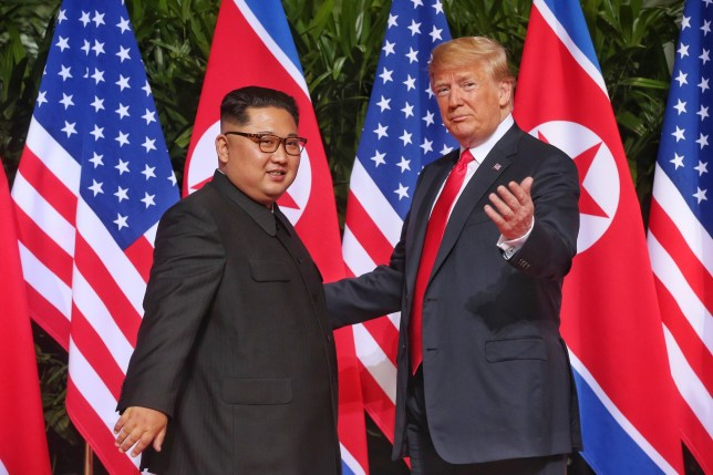 Mandatory Credit: Photo by Kevin Lim/The Straits Times/ZUMA Wire/REX/Shutterstock (9710197h) Top leader of the Democratic People's Republic of Korea (DPRK) Kim Jong-un (L) meets with U.S. President Donald Trump in Singapore before the first-ever DPRK-U.S. summit. Expanded Bilateral Meeting between President of the United States of America Donald Trump and Chairman of the State Affairs Commission of the Democratic People's Republic of Korea Kim Jong-un at Capella, Singapore. US and North Korea summit, Singapore - 11 Jun 2018