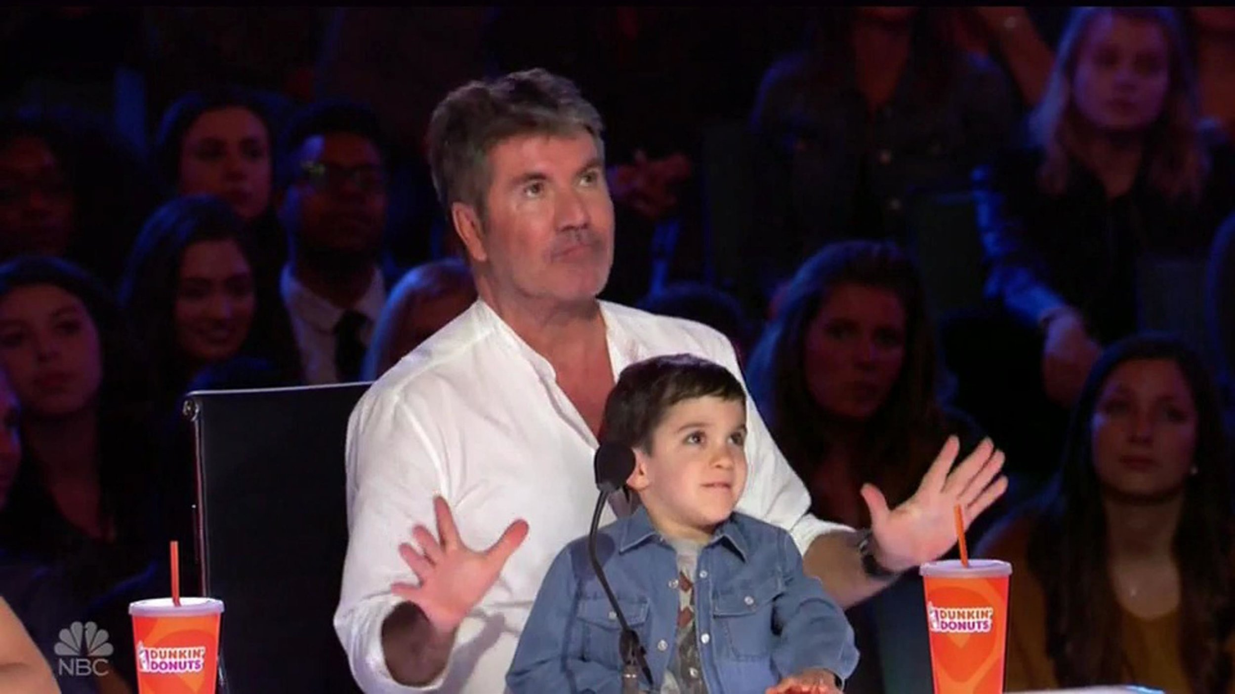 """BGUK_1261148 - ** RIGHTS: WORLDWIDE EXCEPT IN UNITED STATES ** Los Angeles, CA - Simon Cowell jokes he wants his son Eric to date five year-old America's Got Talent contestant Sophie Fatu. Sophie came out on stage with Tyra Banks - and then confidently said she had a dream that judge Simon Cowell would push his golden buzzer for her. He replied: """"Cheeky!"""" Sophie, who lives in Charleston, West Virginia, then sang Frank Sinatra???s My Way. Simon said they were not expecting that. He said he loved that song and usually older people sing it. Simon called her hilarious and said he wanted her to date his son Eric. He quipped: """"I can make an introduction,"""" as Sophie stood on the stage with her mouth open! Simon then said she was adorable while Mel B said that she was so cute and that she sung like an angel. Howie Mandel thought it was amazing and said that she was cute and talented while Heidi Klum said that Sophie should be so proud of herself. Sophie got four yes votes and was sent through to the next round. Viewers were then shown a clip of Cowell's son Eric, four, sitting on his lap before hitting the red X button as the Brit judge told the youngster: """"No, we don't buzz Sophie!"""" *BACKGRID DOES NOT CLAIM ANY COPYRIGHT OR LICENSE IN THE ATTACHED MATERIAL. ANY DOWNLOADING FEES CHARGED BY BACKGRID ARE FOR BACKGRID'S SERVICES ONLY, AND DO NOT, NOR ARE THEY INTENDED TO, CONVEY TO THE USER ANY COPYRIGHT OR LICENSE IN THE MATERIAL. BY PUBLISHING THIS MATERIAL , THE USER EXPRESSLY AGREES TO INDEMNIFY AND TO HOLD BACKGRID HARMLESS FROM ANY CLAIMS, DEMANDS, OR CAUSES OF ACTION ARISING OUT OF OR CONNECTED IN ANY WAY WITH USER'S PUBLICATION OF THE MATERIAL* Pictured: Simon Cowell, son Eric BACKGRID UK 12 JUNE 2018 BYLINE MUST READ: NBC / BACKGRID UK: +44 208 344 2007 / uksales@backgrid.com USA: +1 310 798 9111 / usasales@backgrid.com *UK Clients - Pictures Containing Children Please Pixelate Face Prior To Publication*"""
