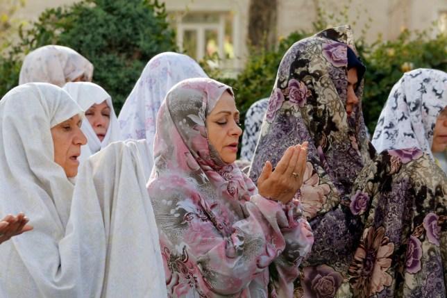 Women carrying out Eid al-Fitr celebrations in Iran