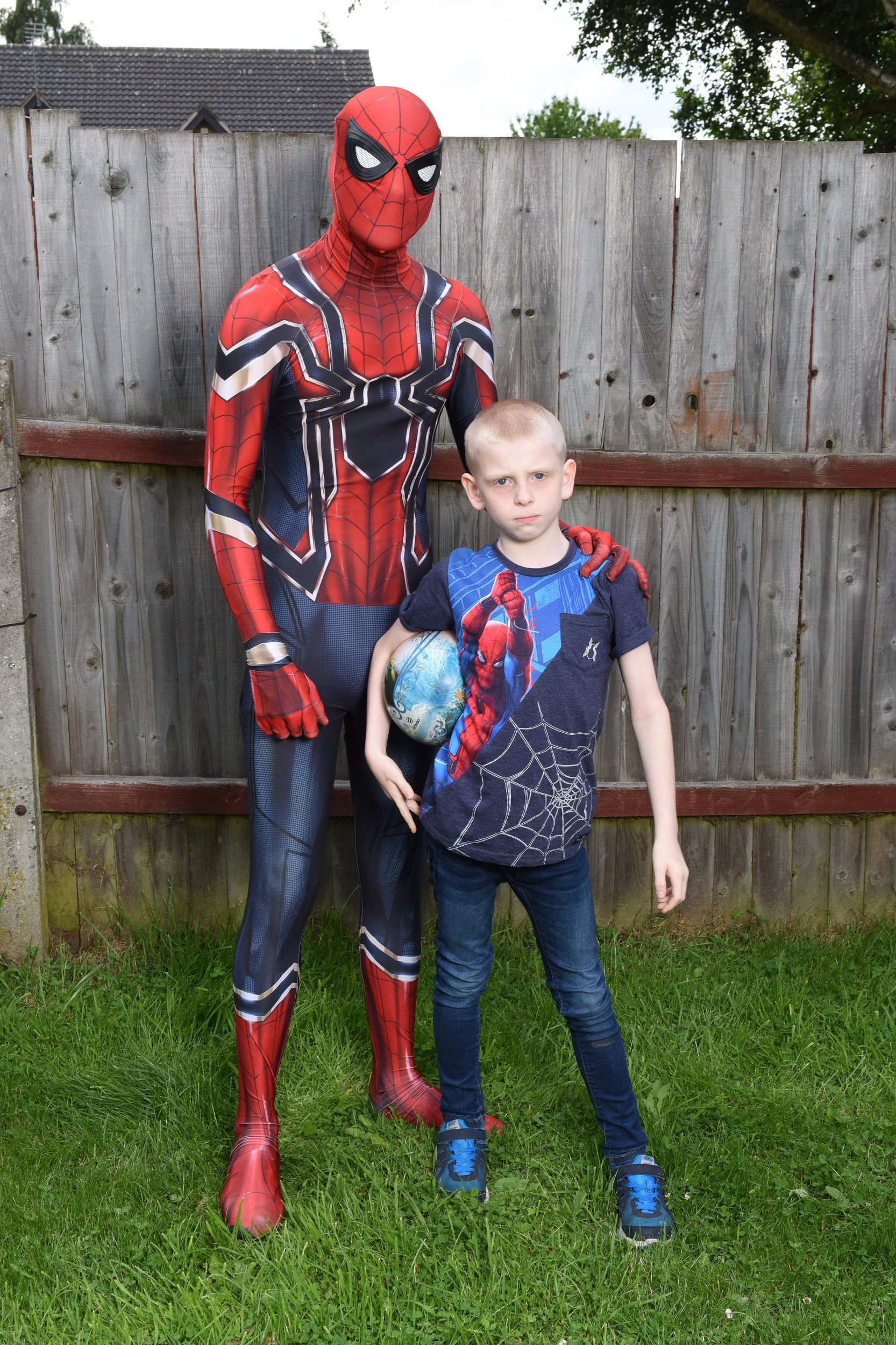 Pics from Caters News - (Reece Grounds, 8, with his Dad Dale Grounds dressed in his Spiderman outfit.) - A single dad from Nottingham has found the perfect way to helps calm his autistic son by transforming himself into SPIDERMAN. Dale Grounds, from Nottingham, has raised son Reece, eight, by himself since Reece was six months old. When Reece was diagnosed with autism in 2015, Dale struggled to find a way to cope with his meltdowns and moods - especially on his own. But he has come up with an ingenious solution - by dressing up as Reeces favourite superhero, Spiderman. Now, when Reece gets stressed, Spider-dad will appear to help him with his homework, have a kickabout in the back garden or read him a bed-time story. His unusual parenting method has been such a hit that hes even started visiting sick kids at his local hospital dressed as the comic book hero - as well as being inundated with requests to appear at Reeces friends birthday parties.- SEE CATERS COPY