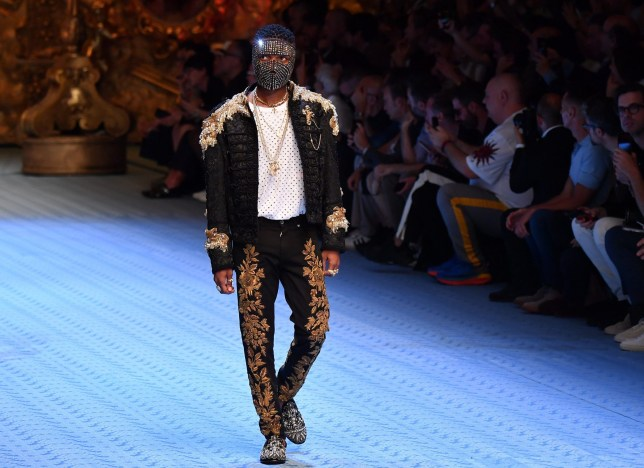 MILAN, ITALY - JUNE 16: Wizkid walks the runway at the Dolce & Gabbana show during Milan Men's Fashion Week Spring/Summer 2019 on June 16, 2018 in Milan, Italy. (Photo by Jacopo Raule/Getty Images)