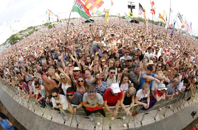 File photo dated 27/06/15 of festival goers at the Glastonbury Festival. Almost half of women under 40 who have been to a UK festival experienced sexual assault or harassment there, according to new research. PRESS ASSOCIATION Photo. Issue date: Monday June 18, 2018. One in five British festival goers have experienced sexual assault or harassment at an event, according to new research. Campaigners said the figures, believed to be the first of their kind, should be a wake-up call for the industry to start treating sexual violence as seriously as other crimes at festivals. See PA story SHOWBIZ Festivals. Photo credit should read: Yui Mok/PA Wire