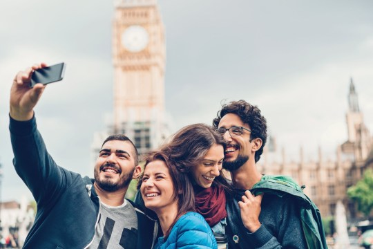 Group of young tourists making a selfie in London city