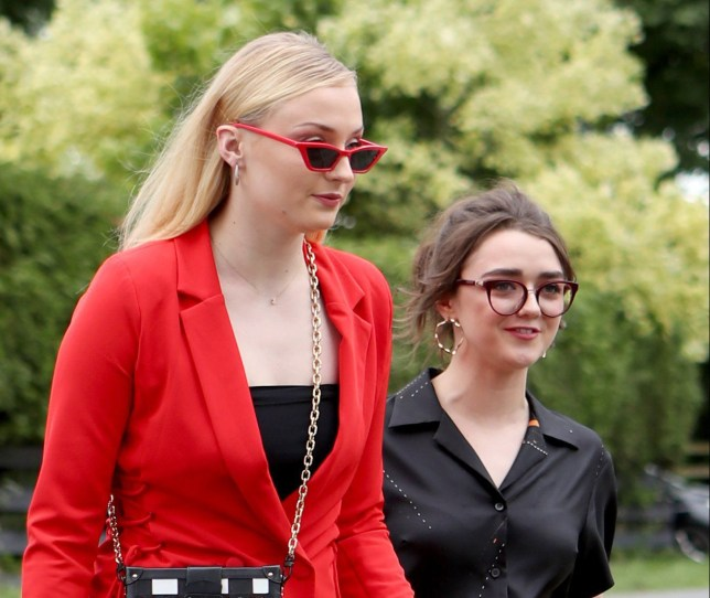 Actresses Sophie Turner (left) and Maisie Williams arrive at Rayne Church, Kirkton of Rayne in Aberdeenshire, for the wedding ceremony of their Game Of Thrones co-stars Kit Harington and Rose Leslie. PRESS ASSOCIATION Photo. Picture date: Saturday June 23, 2018. See PA story SHOWBIZ Snow. Photo credit should read: Jane Barlow/PA Wire