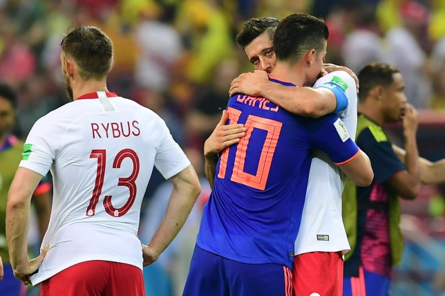TOPSHOT - Poland's forward Robert Lewandowski (R) is comforted by Colombia's midfielder James Rodriguez at the end of the Russia 2018 World Cup Group H football match between Poland and Colombia at the Kazan Arena in Kazan on June 24, 2018. / AFP PHOTO / Luis Acosta / RESTRICTED TO EDITORIAL USE - NO MOBILE PUSH ALERTS/DOWNLOADSLUIS ACOSTA/AFP/Getty Images