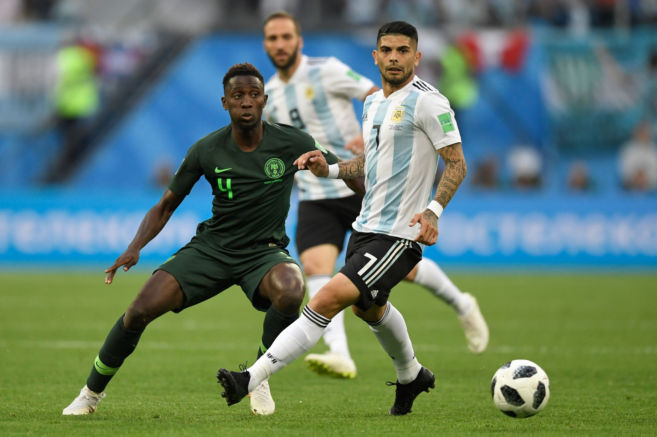 Nigeria's midfielder Onyinye Ndidi (L) and Argentina's midfielder Ever Banega compete for the ball during the Russia 2018 World Cup Group D football match between Nigeria and Argentina at the Saint Petersburg Stadium in Saint Petersburg on June 26, 2018. / AFP PHOTO / GABRIEL BOUYS / RESTRICTED TO EDITORIAL USE - NO MOBILE PUSH ALERTS/DOWNLOADSGABRIEL BOUYS/AFP/Getty Images
