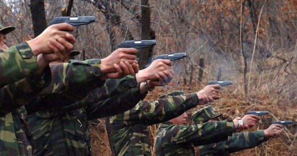 North Korean soldiers take part in a shooting drill in an unknown location in this picture taken on April 6, 2013 and released by North Korea's official KCNA news agency in Pyongyang on April 7, 2013. REUTERS/KCNA (NORTH KOREA - Tags: POLITICS MILITARY) ATTENTION EDITORS - THIS PICTURE WAS PROVIDED BY A THIRD PARTY. REUTERS IS UNABLE TO INDEPENDENTLY VERIFY THE AUTHENTICITY, CONTENT, LOCATION OR DATE OF THIS IMAGE. IT IS DISTRIBUTED, EXACTLY AS RECEIVED BY REUTERS, AS A SERVICE TO CLIENTS. FOR EDITORIAL USE ONLY. NOT FOR SALE FOR MARKETING OR ADVERTISING CAMPAIGNS. NO THIRD PARTY SALES. NOT FOR USE BY REUTERS THIRD PARTY DISTRIBUTORS