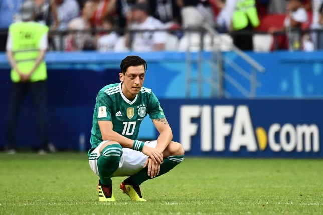 Germany's midfielder Mesut Ozil reacts after South Korea's forward Son Heung-min (unseen) scored the second goal during the Russia 2018 World Cup Group F football match between South Korea and Germany at the Kazan Arena in Kazan on June 27, 2018. / AFP PHOTO / Jewel SAMAD / RESTRICTED TO EDITORIAL USE - NO MOBILE PUSH ALERTS/DOWNLOADSJEWEL SAMAD/AFP/Getty Images