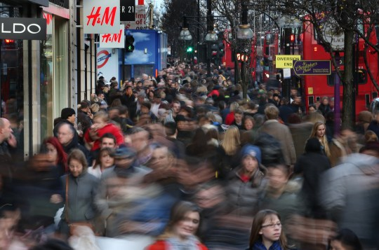 LONDON, ENGLAND - DECEMBER 20: (EDITORS NOTE: A long exposure was used for this image) Shoppers crowd Oxford Street on December 20, 2014 in London, England. Shoppers in the United Kingdom are expected to spend ??1.2 billion on the last Saturday before Christmas. (Photo by Peter Macdiarmid/Getty Images)