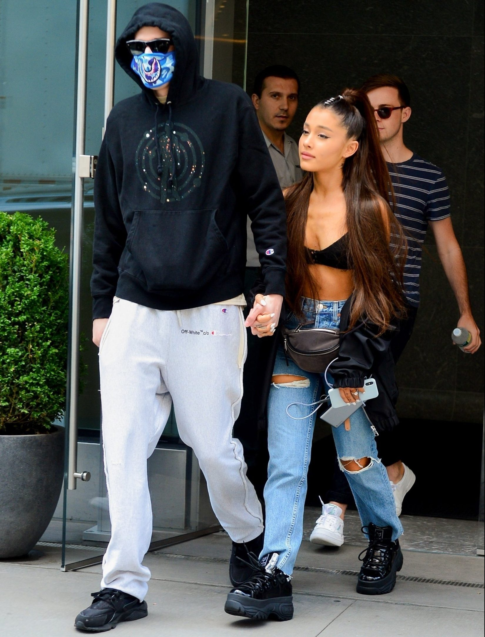 New York, NY - *EXCLUSIVE* Pop superstar Ariana Grande shows some skin as she and her fiance, actor Pete Davidson, are spotted heading out for some shopping with friends in New York. Pete goes incognito with a bandana covering his face, as he steps out holding hands with his lovey girlfriend. Pictured: Pete Davidson, Ariana Grande BACKGRID USA 28 JUNE 2018 USA: +1 310 798 9111 / usasales@backgrid.com UK: +44 208 344 2007 / uksales@backgrid.com *UK Clients - Pictures Containing Children Please Pixelate Face Prior To Publication*