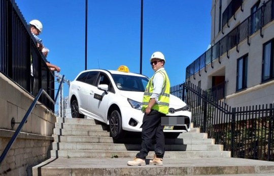 "These funny pictures show the moment an Uber driver had a 'Jason Bourne' moment and got his car stuck - on a set of stairs in a busy city centre. See SWNS story SWTAXI; People were left stunned as the white taxi, complete with Uber branding, was left dangling over the top step - unable to reverse or go forwards. Witnesses said they believed the driver had been following his sat nav and assumed the route took him that way. Cabbie Paul Roles, 54, witnessed the gaffe in Bath, Somerset, and said it took over an hour to free the stricken car. He said: ""It just shows you how much these Uber drivers rely on sat nav. It clearly told the driver to make a turn and it?s taken him right down these steps. ?Taxi drivers need to have local knowledge so things like this do not happen. You can?t just rely on sat nav.?"