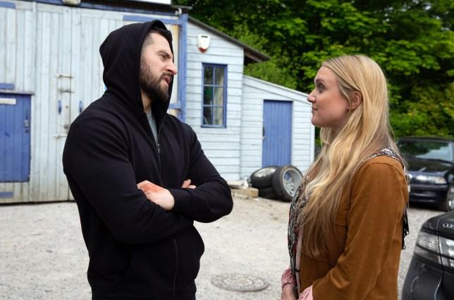 Ross helps Rebecca in Emmerdale