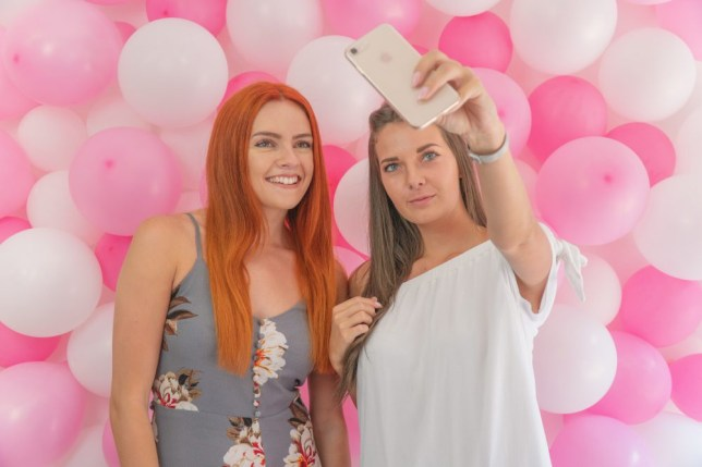 Girls taking selfies in front of a balloon wall which they paif £12.50 for the privilege for