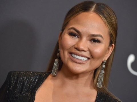 Chrissy Teigen ignores breastfeeding critics with stunning picture doing just that