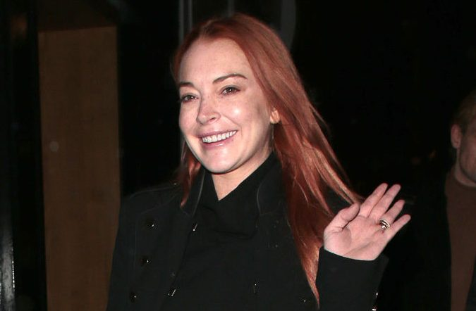 Lindsay Lohan waving