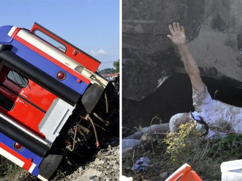Picture shows man desperately signalling for help after train derails in Turkey