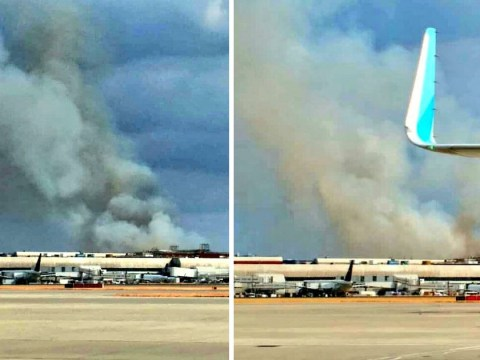 Thick black smoke over Heathrow Airport as firefighters tackle huge grass blaze