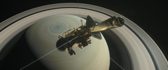 FILE PHOTO: The spacecraft Cassini is pictured above Saturn's northern hemisphere prior to making one of its Grand Finale dives in this NASA handout illustration obtained by Reuters August 29, 2017. NASA/Handout via REUTERS ATTENTION EDITORS - THIS IMAGE WAS PROVIDED BY A THIRD PARTY./File Photo