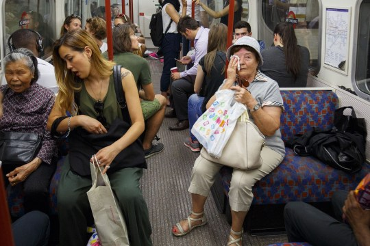 Mandatory Credit: Photo by Tolga Akmen/LNP/REX/Shutterstock (5775341t) People commute on the tube in London on the UK's hottest day of the year so far Seasonal weather, London, UK - 19 Jul 2016