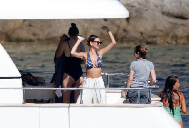 BGUK_1277930 - ** RIGHTS: WORLDWIDE EXCEPT IN GREECE ** Mykonos, GREECE - Models Emily Ratajkowski and Gigi Hadid enjoy a day at sea dancing and taking pictures on a yacht in Mykonos. Emily Ratajkowski, 27, displayed her flawless figure in a skimpy polka dot two-piece blue bikini as she enjoyed a boat trip with Gigi. Gigi Hadid, 23, showed her slender frame in a one-piece black bikini. Pictured: Gigi Hadid, Emily Ratajkowski BACKGRID UK 1 JULY 2018 UK: +44 208 344 2007 / uksales@backgrid.com USA: +1 310 798 9111 / usasales@backgrid.com *UK Clients - Pictures Containing Children Please Pixelate Face Prior To Publication*
