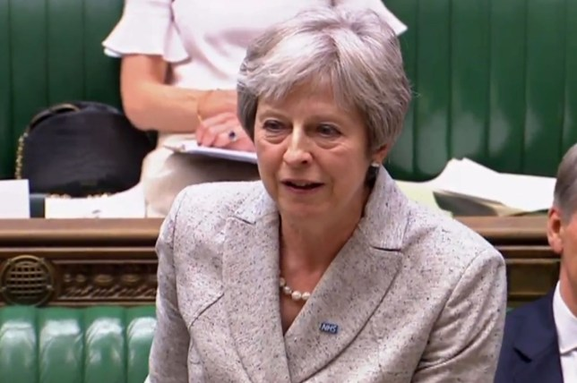 """In this video grab taken from footage broadcast by the UK Parliamentary Recording Unit (PRU) via the Parliament TV website on July 2, 2018, Britain's Prime Minister Theresa May answers questions after making a statement in the House of Commons on the EU summit and Brexit developments. / AFP PHOTO / PRU / Handout / RESTRICTED TO EDITORIAL USE - NO USE FOR ENTERTAINMENT, SATIRICAL, ADVERTISING PURPOSES - MANDATORY CREDIT """" AFP PHOTO / PRU """" HANDOUT/AFP/Getty Images"""
