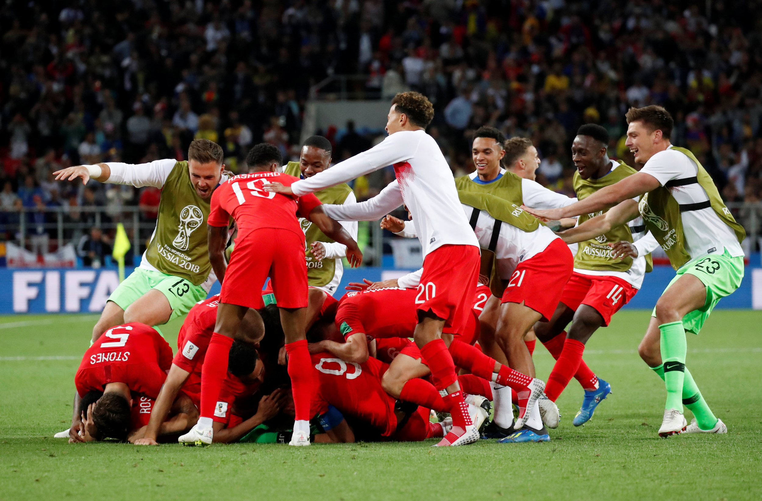 Soccer Football - World Cup - Round of 16 - Colombia vs England - Spartak Stadium, Moscow, Russia - July 3, 2018 England's Eric Dier celebrate winning the penalty shootout with team mates REUTERS/Maxim Shemetov