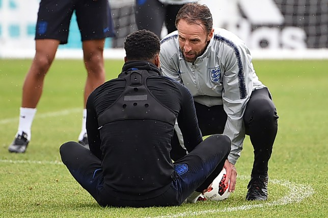 England's coach Gareth Southgate (R) talks to forward Marcus Rashford during a training session in Repino on July 4, 2018, ahead of their Russia 2018 World Cup quarter-final match against Sweden. / AFP PHOTO / Paul ELLISPAUL ELLIS/AFP/Getty Images