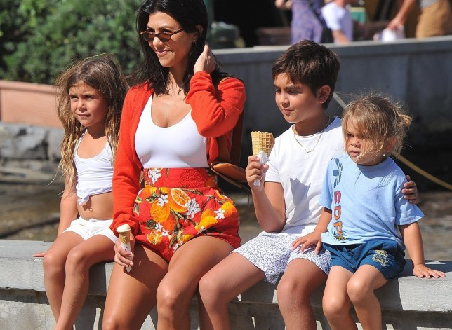 BGUK_1279941 - ** RIGHTS: WORLDWIDE EXCEPT IN ITALY ** Portofino, ITALY - *EXCLUSIVE* - Reality star Kourtney Kardashian and her adorable children Mason, Penelope and Reign share a nice family moment as they indulge in eating some ice cream whilst on holiday in Portofino. Pictured: Kourtney Kardashian BACKGRID UK 4 JULY 2018 BYLINE MUST READ: Cucu / BACKGRID UK: +44 208 344 2007 / uksales@backgrid.com USA: +1 310 798 9111 / usasales@backgrid.com *UK Clients - Pictures Containing Children Please Pixelate Face Prior To Publication*