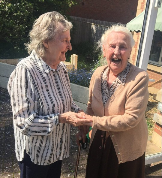 MERCURY PRESS. 06/07/18. Pictured: L-R Ann Patrick, 79, and Marguerita Wilson, 88. This is the incredibly touching moment two sisters with Alzheimers see each other for the first time in 15 years. Despite now struggling to communicate because of her condition, Ann Patrick was clearly delighted when she recognised her long-lost sister Marguerita Wilson. After they both set eyes on each other Ann pulled her big sister in for a heart-warming hug and gently rubbed her cheek. Marguerita, 88, whose condition is not as advanced as Annas, burst into tears when she finally got to hug her sister again. SEE MERCURY COPY