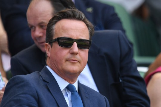 Former British Prime Minister David Cameron arrives on centre court to watch US player Sam Querrey play France's Gael Monfils in their men's singles third round match on the fifth day of the 2018 Wimbledon Championships at The All England Lawn Tennis Club in Wimbledon, southwest London, on July 6, 2018. / AFP PHOTO / Glyn KIRK / RESTRICTED TO EDITORIAL USEGLYN KIRK/AFP/Getty Images