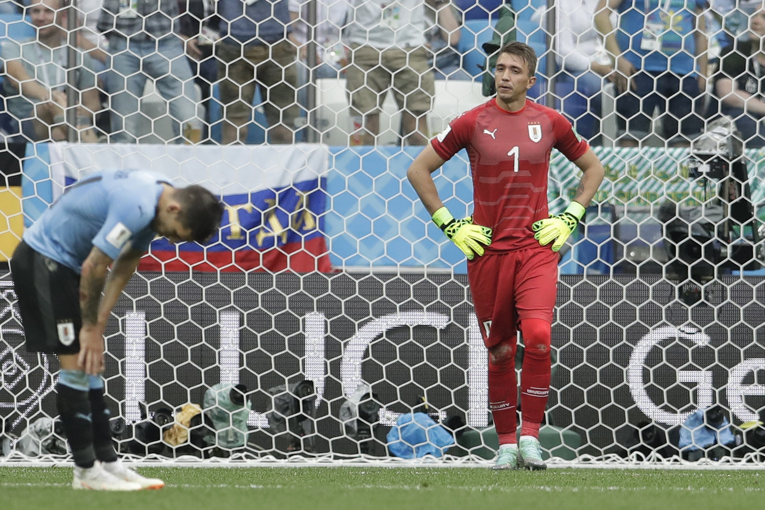 Uruguay goalkeeper Fernando Muslera, right, reacts after France's Antoine Griezmann scored his side's second goal during the quarterfinal match between Uruguay and France at the 2018 soccer World Cup in the Nizhny Novgorod Stadium, in Nizhny Novgorod, Russia, Friday, July 6, 2018. (AP Photo/Petr David Josek)