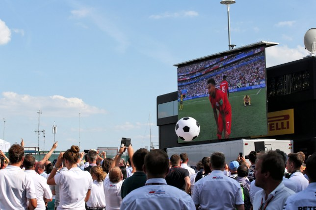 XPB via PA Images The England vs Sweden World Cup Quarter Final is shown on a big screen at the Heineken Bar in the paddock. 07.07.2018. Formula 1 World Championship, Rd 10, British Grand Prix, Silverstone, England, Qualifying Day. Photo credit should read: XPB/Press Association Images.