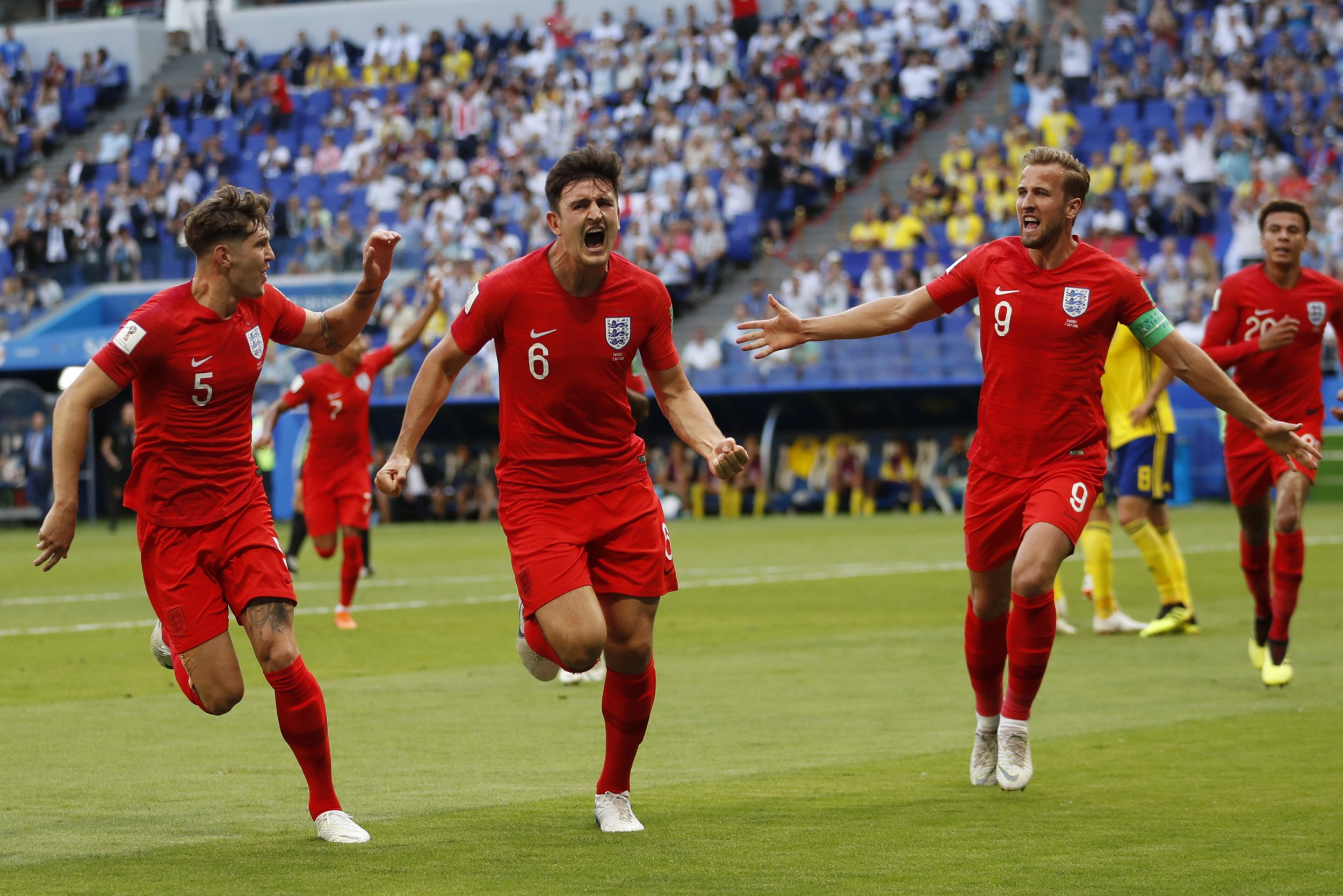 England's Harry Maguire shouts as he celebrates after scoring his side opening goal during the quarterfinal match between Sweden and England at the 2018 soccer World Cup in the Samara Arena, in Samara, Russia, Saturday, July 7, 2018. (AP Photo/Francisco Seco)