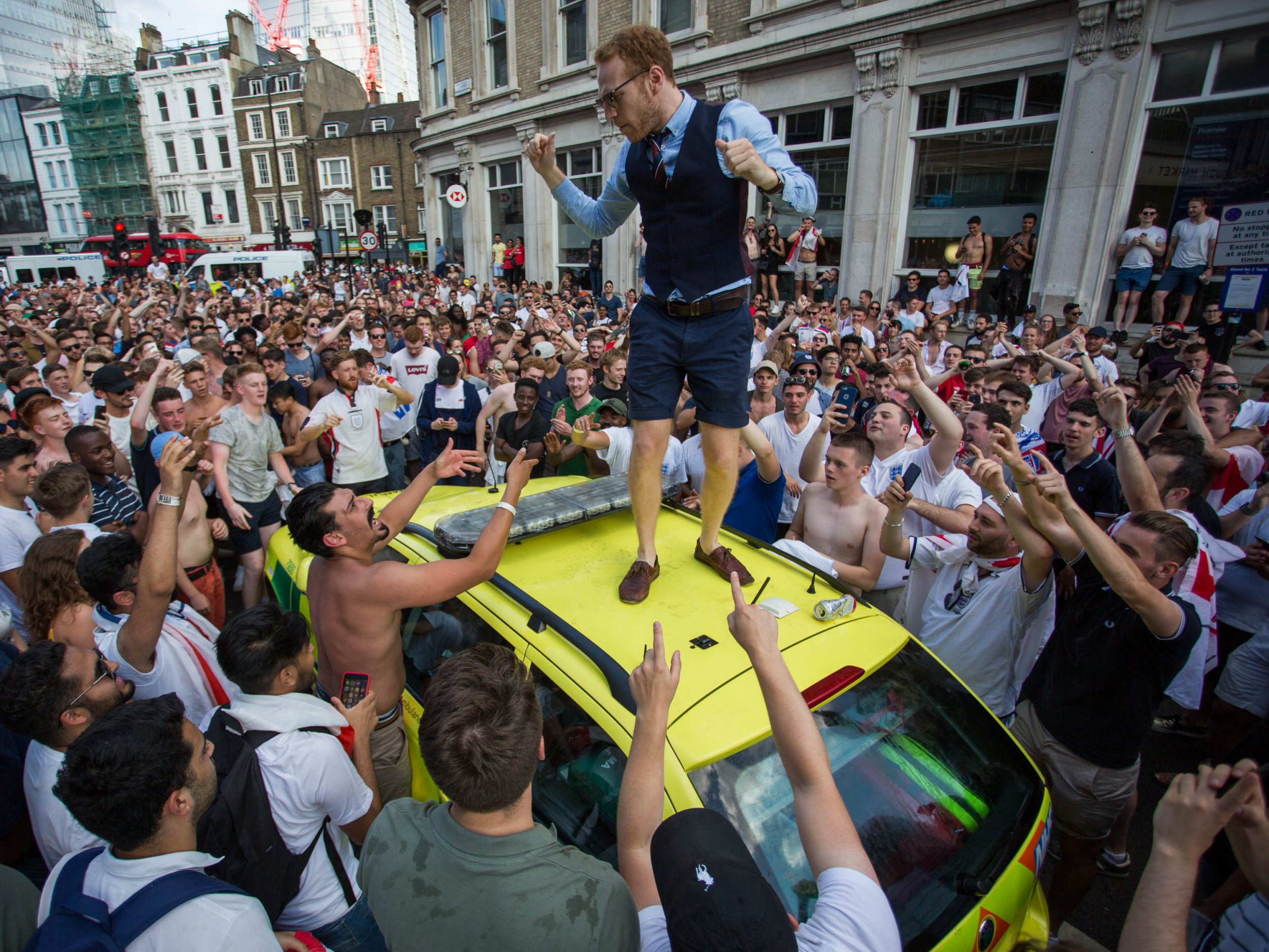 Football fans celebrate England's World Cup victory over Sweden in the quarter finals of the 2018 FIFA World Cup at London Bridge. An ambulance was trashed by fans with sporadic outbreaks of fighting in side streets. Featuring: Atmosphere, View Where: London, England, United Kingdom When: 07 Jul 2018 Credit: Wheatley/WENN