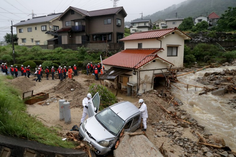 epa06873184 Rescue worker search missing people in Hiroshima, Hiroshima Prefecture, Japan, 08 July 2018. Heavy rainfall killed 65 people and missing more than 45 people in southwestern and western Japan, public television reported on 08 July 2018. Japan Meteorological Agency has warned record rainfall on 06 July for flooding, mudslides in southwestern and western Japan through 08 July and issued emergency weather warnings to six prefectures. In nine prefectures in western and southwestern Japan, authorities issued evacuation orders to more than one million people as Typhoon Maria passes the area. EPA/JIJI PRESS JAPAN OUT EDITORIAL USE ONLY NO ARCHIVES