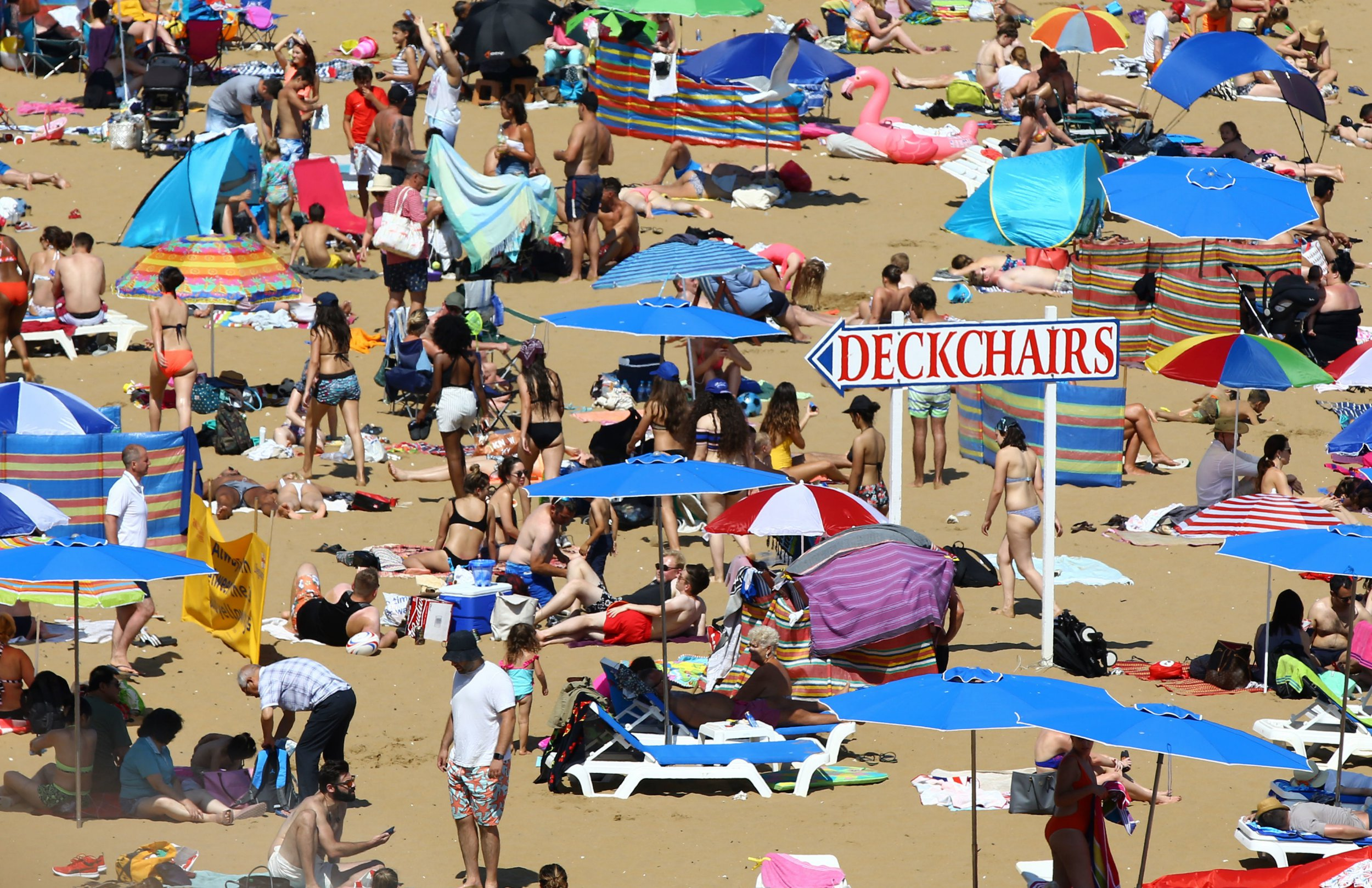 People enjoy the beach in Broadstairs, Kent, as the warm weather continues across the country. PRESS ASSOCIATION Photo. Picture date: Sunday July 8, 2018. Photo credit should read: Gareth Fuller/PA Wire