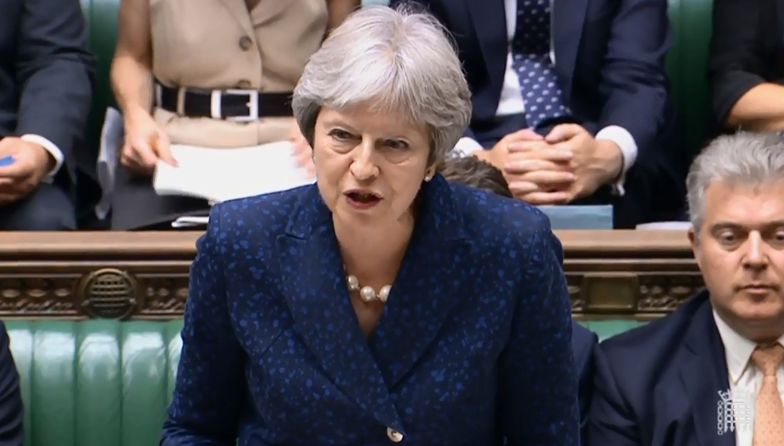 """A video grab from footage broadcast by the UK Parliament's Parliamentary Recording Unit (PRU) shows Britain's Prime Minister Theresa May giving a statement to the the House of Commons on Brexit in London on July 9, 2018. British Prime Minister Theresa May's government imploded on July 9 as Foreign Secretary Boris Johnson followed Brexit minister David Davis out the exit door over her masterplan for Britain's future outside the EU. / AFP PHOTO / PRU / HO / RESTRICTED TO EDITORIAL USE - NO USE FOR ENTERTAINMENT, SATIRICAL, ADVERTISING PURPOSES - MANDATORY CREDIT """" AFP PHOTO / PRU """"HO/AFP/Getty Images"""