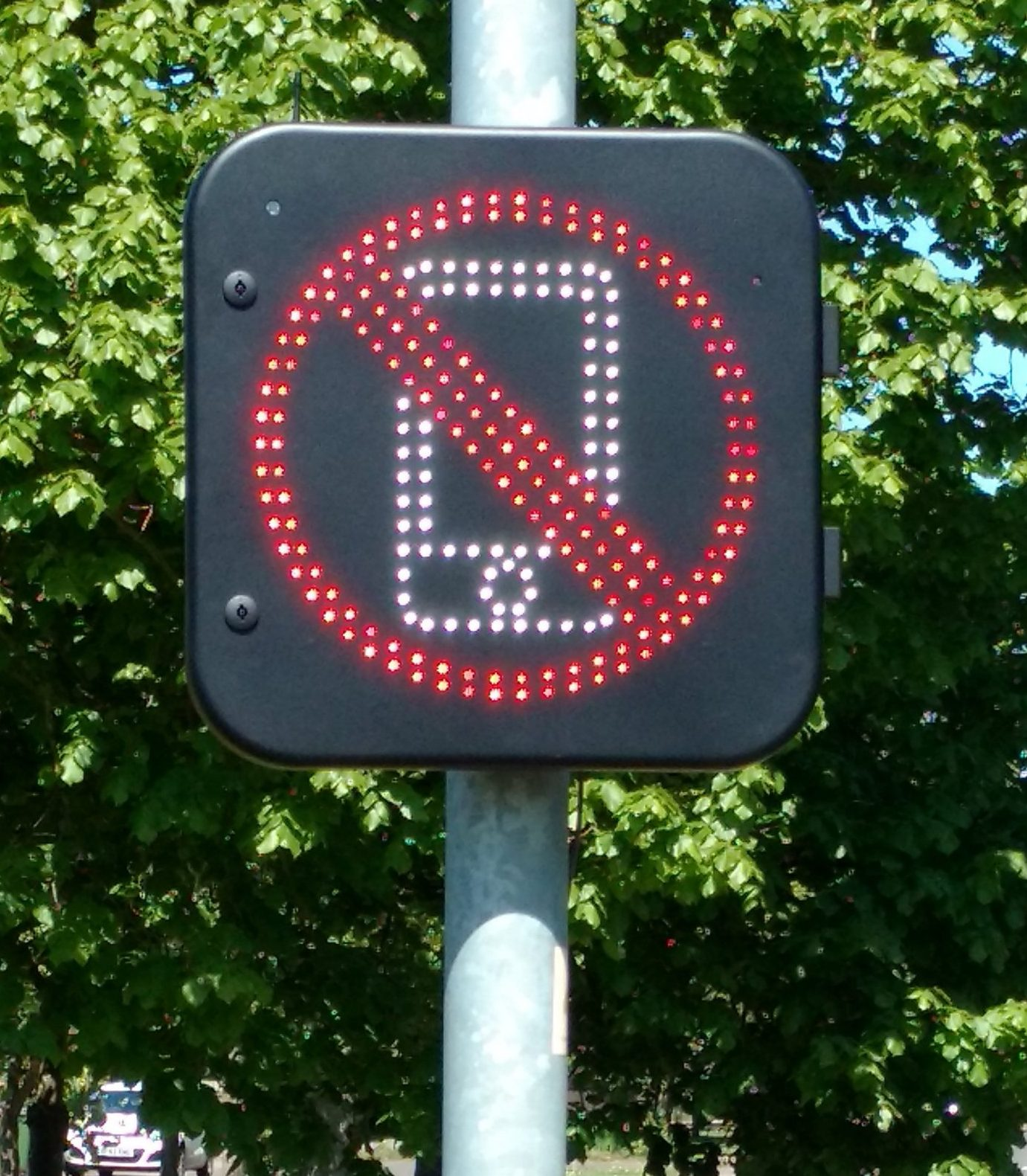 The new sign in Norwich, Norfolk that detects when people are using their phones on the road. Unruly motorists who use their mobile phone while driving will be warned to put it away by an innovative new road sign. The sign, which is launched today in Norwich, Norfolk(10july), is the first of its kind in Britain and can detect when signals are being transmitted by a handset inside a car or simply its Bluetooth system. Similar to speed warning signs which flash when the speed limit is exceeded, the road sign will light up as the driver passes - prompting them to stop using their phone.