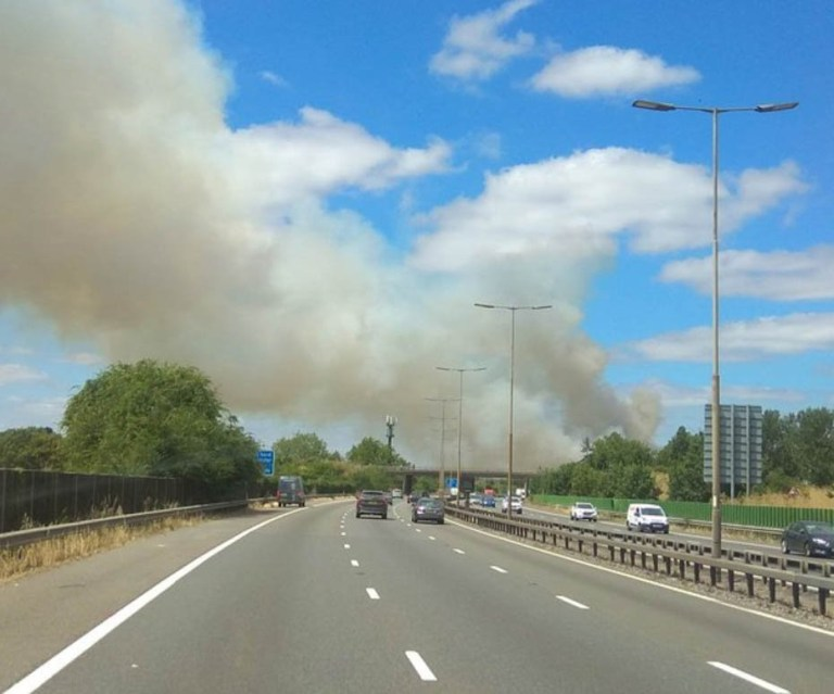 Field Fire Threatens to close the M4 Motorway near Slough Fifty Five fire-fighters and six appliances from Berkshire,Hampshire,Bucks,Surrey and London are currently dealign with a major fire on the Datchet Road on the outskirts of Slough. The blaze bork out just after 1pm on Tuesday afternoon. A number of road have already been closed. Thames Valley Police are also working with the fire service and have put in road closures at Eton road and Datchet Road. Crew where mobilise just after 1pm on Tuesday 10th July 2018 Six fire appliances have been deployed and road closure are being out in place as safety measures. Be prepared for further potential road closures. It is understood that if the fire spreads it may cover parts of the M4 Motorway and a closure may have to be put in place Advice from Royal Berkshire Fire and Rescue who are incident managing the fire is : Please avoid the area where at all possible. Further Road Closures have been put in place at Pococks Lane and The Myrke in Slough, Datchet Road is closed both ways to all traffic. Smoke is also affecting the M4 between 5 and 6