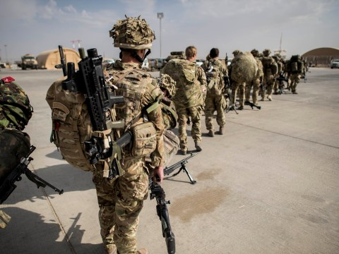 UK pledge to send 400 more troops to Afghanistan at tense Nato summit